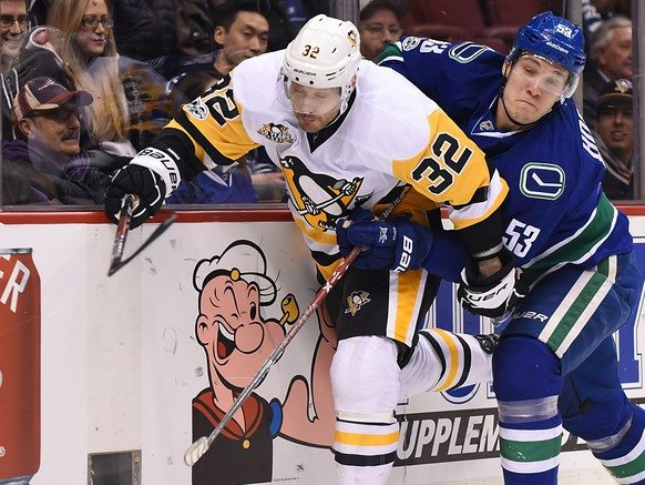 Mar 11, 2017; Vancouver, British Columbia, CAN; Vancouver Canucks forward Bo Horvat (53) checks Pittsburgh Penguins  defenseman Mark Streit (32) during the first period at Rogers Arena. Mandatory Credit: Anne-Marie Sorvin-USA TODAY Sports