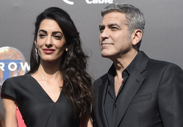 Amal Clooney, left, and George Clooney arrive at the world premiere of