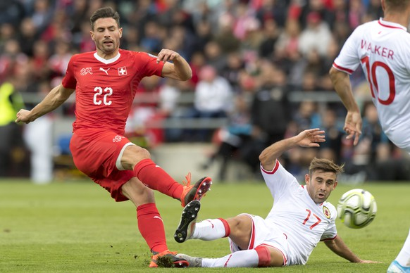Switzerland's defender Fabian Schaer, left, fights for the ball with Gibraltar's midfielder Andrew Hernandez, right, during the UEFA Euro 2020 qualifying Group D soccer match between the Switzerland and Gibraltar, at the Tourbillon Stadium in Sion, Switzerland, Sunday, September 8, 2019. (KEYSTONE/Laurent Gillieron)