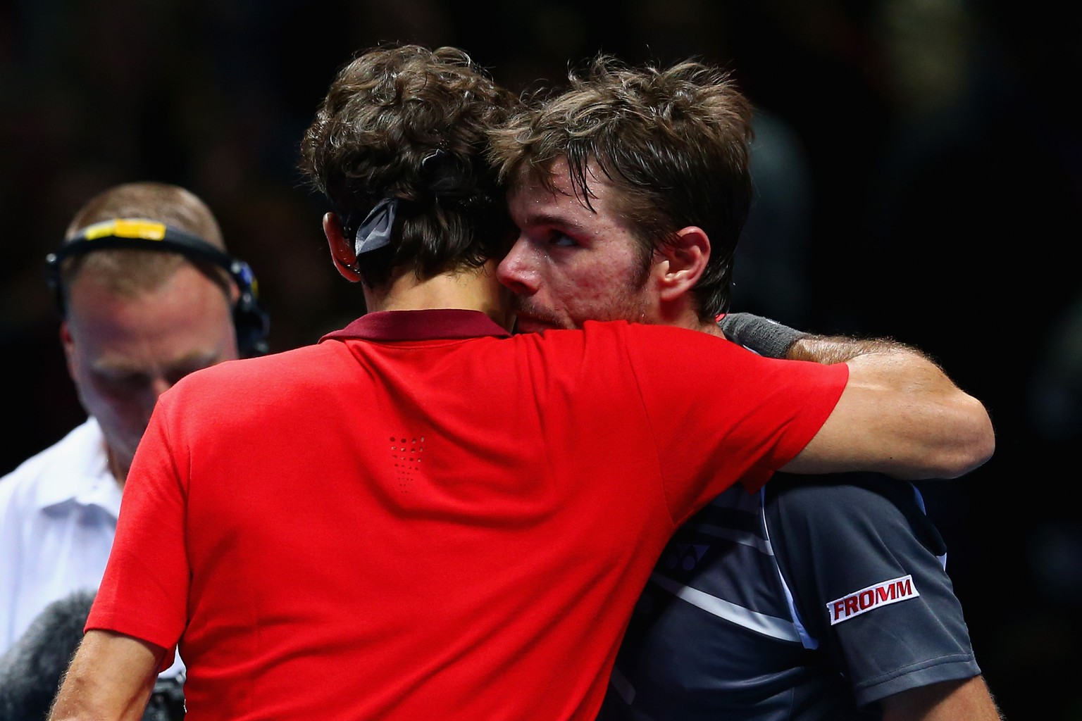 LONDON, ENGLAND - NOVEMBER 15:  Roger Federer of Switzerland hugs Stan Wawrinka of Switzerland afte the singles semi-final match  on day seven of the Barclays ATP World Tour Finals at O2 Arena on November 15, 2014 in London, England.  (Photo by Clive Brunskill/Getty Images)