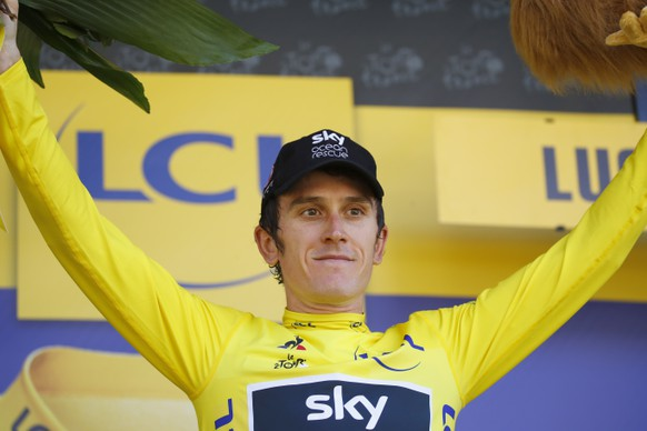 epa06908239 Team Sky rider Geraint Thomas of Britain celebrates on the podium wearing the overall leader yellow jersey following the 16th stage of the 105th edition of the Tour de France cycling race over 218km between Carcassonne and Bagneres-de-Luchon, France, 24 July 2018.  EPA/KIM LUDBROOK