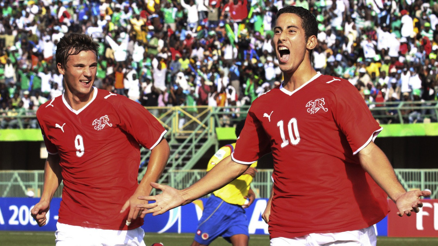 Switzerland's Nassim Ben Khalifa, right, reacts with fellow team member Haris Seferovic, left, after scoring on a penalty kick against Colombia during their Under-17 World Cup semifinal soccer match in Lagos, Nigeria, Thursday, Nov. 12, 2009. (AP Photo/Sunday Alamba)