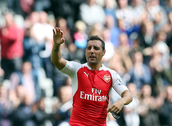 Arsenal's captain Santi Cazorla celebrates the victory at the end of their English Premier League soccer match between Newcastle United and Arsenal at St James' Park, Newcastle, England, Saturday, Aug. 29, 2015. (AP Photo/Scott Heppell)