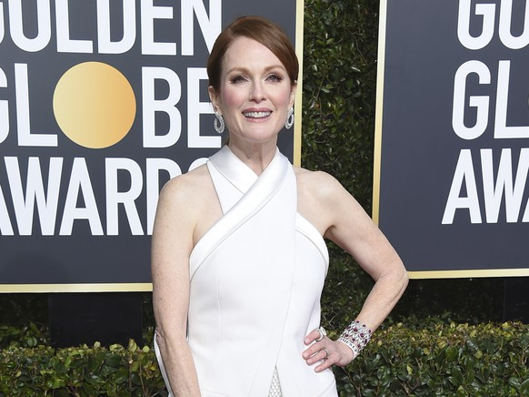 FILE - In this Jan. 6, 2019 file photo, Julianne Moore arrives at the 76th annual Golden Globe Awards in Beverly Hills, Calif. Moore has helped New York Gov. Andrew Cuomo's administration unveil the governor's series of initiatives aimed at improving the lives of women in New York. Cuomo's list of proposals for 2019 includes eliminating the statute of limitations for rape claims and increasing protections against sexual harassment in the workplace. (Photo by Jordan Strauss/Invision/AP, File)