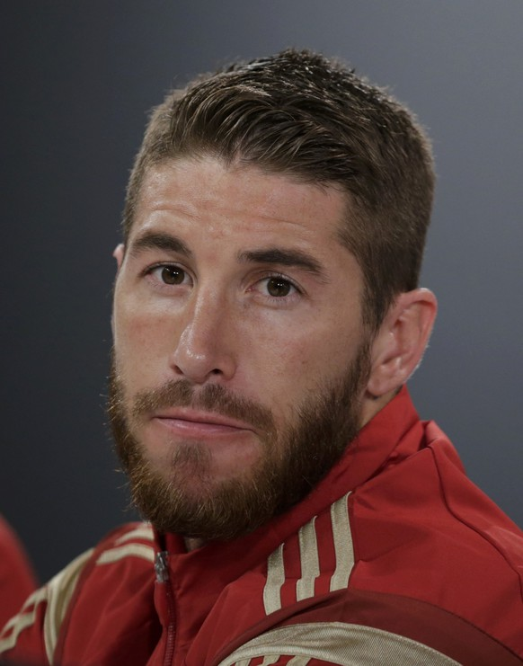Spain's defender Sergio Ramos listen during  a news conference in Curitiba, June 14, 2014.    REUTERS/Henry Romero (BRAZIL  - Tags:  SOCCER SPORT WORLD CUP)
