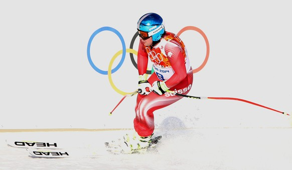 epa04075804 Beat Feuz of Switzerland in action during the Downhill portion of the Men's Super Combined competition at the Rosa Khutor Alpine Center during the Sochi 2014 Olympic Games, Krasnaya Polyana, Russia, 14 February 2014.  EPA/ANTONIO BAT