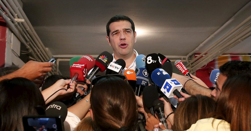 Former Greek prime minister and leader of leftist Syriza party Alexis Tsipras speaks to journalists after he voted for the general election at a polling station in Athens, Greece, September 20, 2015. Tsipras's leftist Syriza party was ahead of its main rival, conservative New Democracy, as voting ended in Greece's election on Sunday, an exit poll showed.  REUTERS/Alkis Konstantinidis