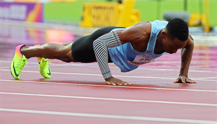 epa06134067 Botswana's Isaac Makwala does push-ups after running a repeat of the men's 200m heats at the London 2017 IAAF World Championships in London, Britain, 09 August 2017. Following a protest by the Botswanan federation and a medical examination, the IAAF Jury of Appeal allowed Makwala to run again on his own.  EPA/SRDJAN SUKI