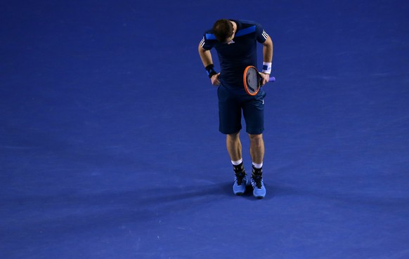 Andy Murray of Britain looks down between points during his quarterfinal against Roger Federer of Switzerland at the Australian Open tennis championship in Melbourne, Australia, Wednesday, Jan. 22, 2014.(AP Photo/Eugene Hoshiko)