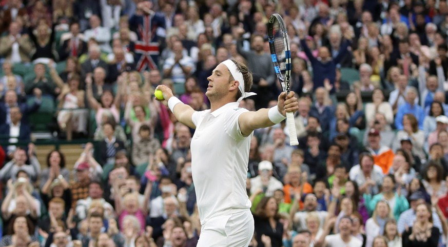 Marcus Willis of Britain celebrates a point against Roger Federer of Switzerland during their men's singles match on day three of the Wimbledon Tennis Championships in London, Wednesday, June 29, 2016. (AP Photo/Tim Ireland)