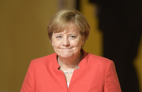 epa06072909 German Chancellor Angela Merkel at the opening day of the G20 summit in Hamburg, Germany, 07 July 2017. The G20 Summit (or G-20 or Group of Twenty) is an international forum for governments from 20 major economies. The summit is taking place in Hamburg 07 to 08 July 2017.  EPA/CLEMENS BILAN