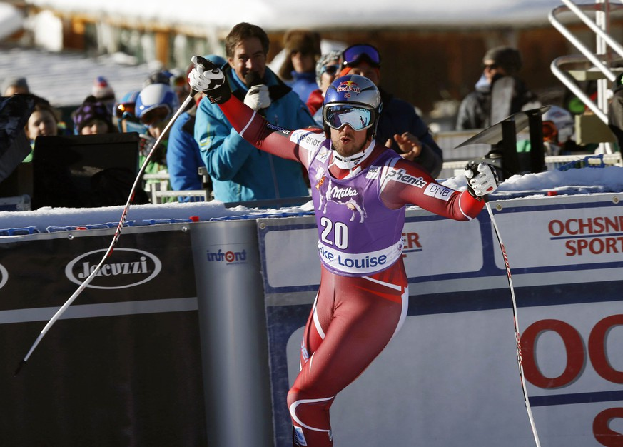 Aksel Lund Svindal of Norway reacts in the finish area following his run at the men's World Cup downhill skiing race in Lake Louise, Alberta, Saturday, Nov. 28, 2015. (Jeff McIntosh/The Canadian Press via AP) MANDATORY CREDIT