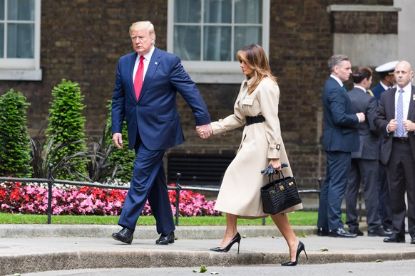 epa07624169 US President Donald J. Trump (L) and his wife Melania Trump (R) attend a meeting with Britain's Prime Minister Theresa May and her husband Philip May at 10 Downing Street in London, Britain, 04 June 2019. US President Trump and his wife are on a three-day official visit to Britain.  EPA/VICKIE FLORES