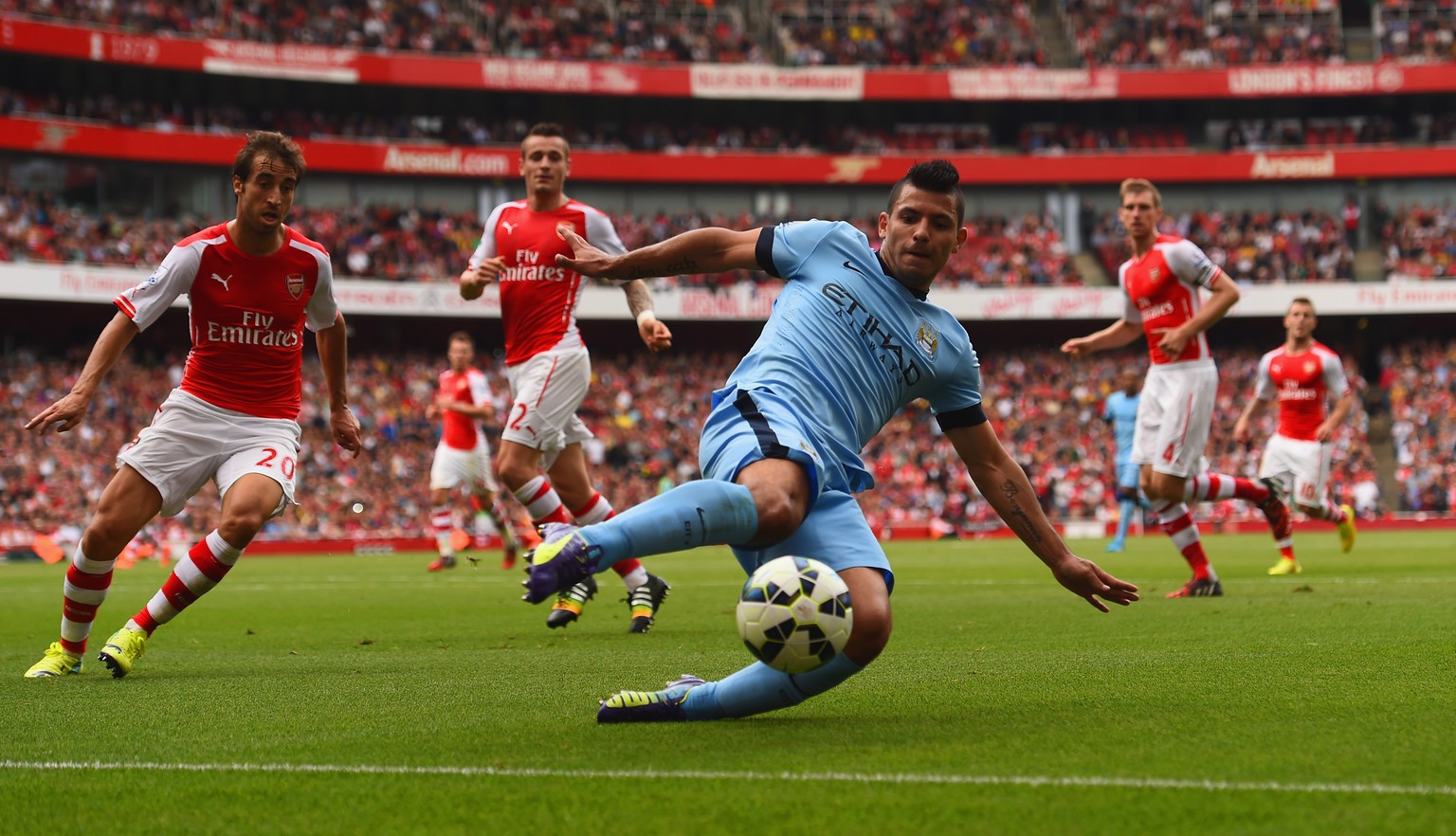 LONDON, ENGLAND - SEPTEMBER 13:  Sergio Aguero of Manchester City stretches for the ball during the Barclays Premier League match between Arsenal and Manchester City at Emirates Stadium on September 13, 2014 in London, England.  (Photo by Shaun Botterill/Getty Images)
