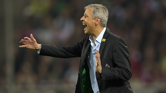 Moenchengladbach's head coach Lucien Favre reacts during the German Bundesliga soccer match between Borussia Moenchengladbach and Bayern Munich in Moenchengladbach,  Germany, Sunday, Oct. 26, 2014. (AP Photo/Martin Meissner)