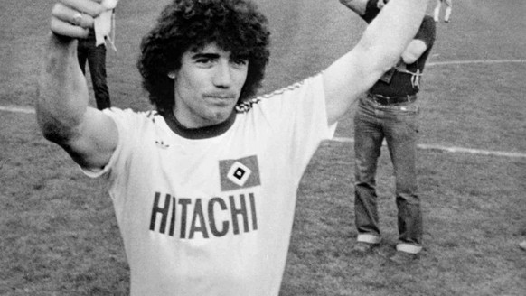 British soccer star Kevin Keegan is all smiles when he was honoured as Football Player of the Year, in Hamburg, Germany, on May 19, 1979, prior to West German First Division soccer match between Hamburg and Frankfurt. (AP Photo/Koerner)