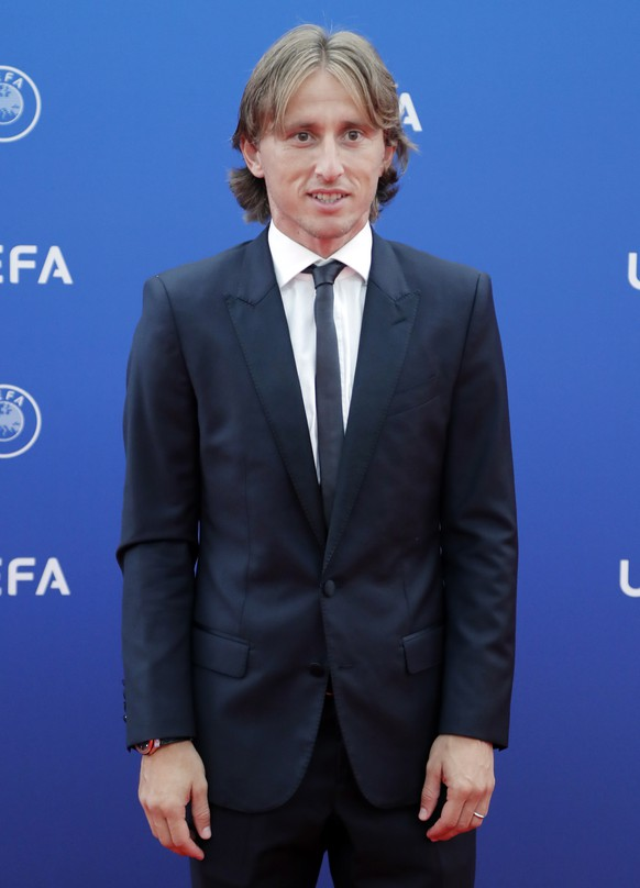 epa06984420 Croatian player Luka Modric of Real Madrid arrives for the UEFA Champions League Group Stage Draw and Awards in Monaco, 30 August 2018.  EPA/GUILLAUME HORCAJUELO
