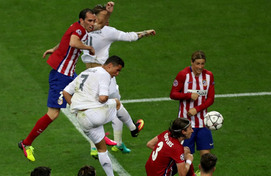 Real Madrid's Cristiano Ronaldo fights for the ball against Atletico's Fernando Torres and Filipe Luis during the Champions League final soccer match between Real Madrid and Atletico Madrid at the San Siro stadium in Milan, Italy, Saturday, May 28, 2016.  (AP Photo/Alessandra Tarantino)