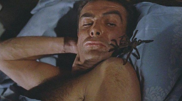 A tarantula, which has been placed in James' bed, crawls up under the sheets. Dr. No ordered the hit.