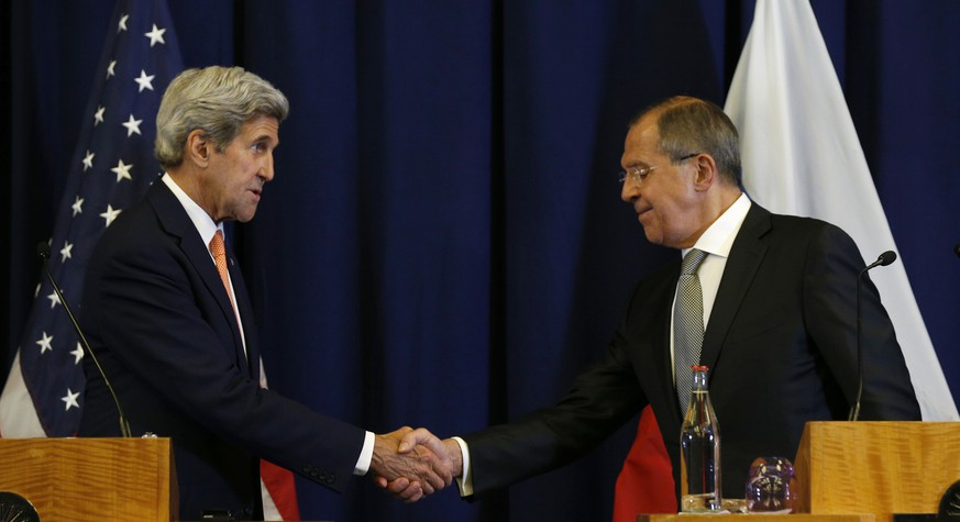 U.S. Secretary of State John Kerry, left, and Russian Foreign Minister Sergei Lavrov shake hands at the conclusion of a joint press conference following their meeting in Geneva, Switzerland Friday, Sept. 9, 2016. (Kevin Lamarque/Pool Photo via AP)