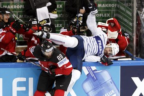 Canada's Brent Burns, left, checks France's Sacha Treille, right, during the IIHF 2015 World Championship preliminary round game France vs Canada, at the O2 Arena, in Prague, Czech Republic, Saturday, May 9, 2015. (KEYSTONE/Salvatore Di Nolfi)