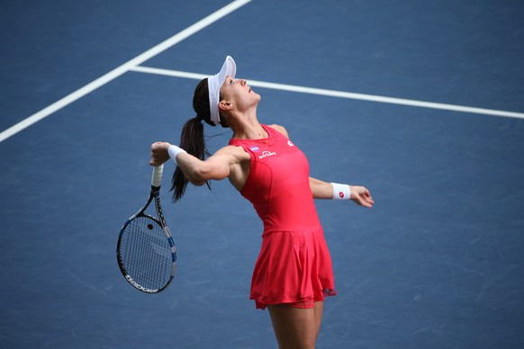 Agnieszka Radwanska of Poland plays against Dominika Cibulkova of Slovakiaduring a semifinal match at the Pan Pacific Open women's tennis tournament in Tokyo, Saturday, Sept. 26, 2015. (AP Photo/Eugene Hoshiko)
