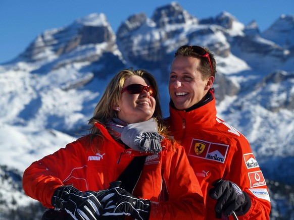 epa07258291 (FILE) German seven time Formula 1 champion Michael Schumacher (R, team Ferrari) and his wife Corinna smile in front of a mountain panorama in the ski resort of Madonna di Campiglio, Italy, 12 January 2005 (reissued 02 Janury 2019). Michael Schumacher's wife Corinna has released a rare statement ahead of the Formula One star's 50th birthday on 03 January 2018.  EPA/OLIVER MULTHAUP GERMANY OUT *** Local Caption *** 00345129