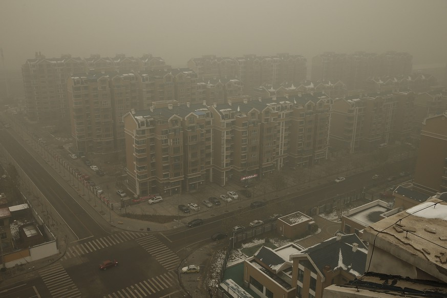 BEIJING, CHINA - DECEMBER 01:  Heavy haze surrounds the a residence community on December 1, 2015 in Beijing, China. China's capital and many cities in the northern part of the country recorded the worst smog of the year with air quality devices in some areas unable to read such high levels of pollutants. Levels of PM 2.5, considered the most hazardous, crossed 600 units in Beijing, nearly 25 times the acceptable standard set by the World Health Organization. The governments of more than 190 countries are meeting in Paris this week to set targets on reducing carbon emissions in an attempt to forge a new global agreement on climate change. (Photo by Lintao Zhang/Getty Images)