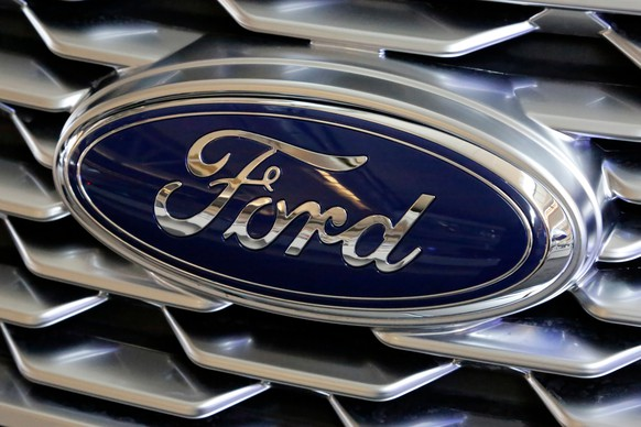 FILE- This Feb. 15, 2018, file photo shows a Ford logo on the grill of a car on display at the Pittsburgh Auto Show. Ford is recalling nearly 1.3 million Focus compact cars in the U.S. because a fuel system problem can cause the engines to stall without warning. (AP Photo/Gene J. Puskar, File)