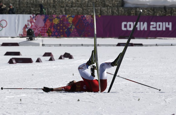 Japan's Hiroyuki Miyazawa lies on the ground after competing in the men's relay 4x10km cross-country event at the Sochi 2014 Winter Olympic Games in Rosa Khutor February 16, 2014.       REUTERS/Sergei Karpukhin (RUSSIA  - Tags: SPORT SKIING OLYMPICS)