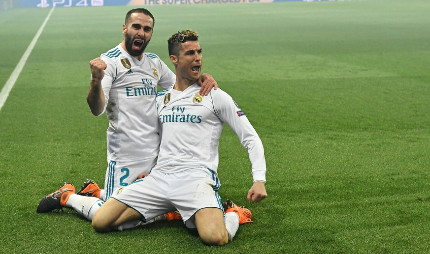 epa06585638 Real Madrid's Cristiano Ronaldo (R) celebrates scoring with Real Madrid's Dani Carvajal during the UEFA Champions League round of 16 second leg soccer match between Paris Saint Germain (PSG) and Real Madrid in Paris, France, 06 March 2018.  EPA/Christophe Petit Tesson