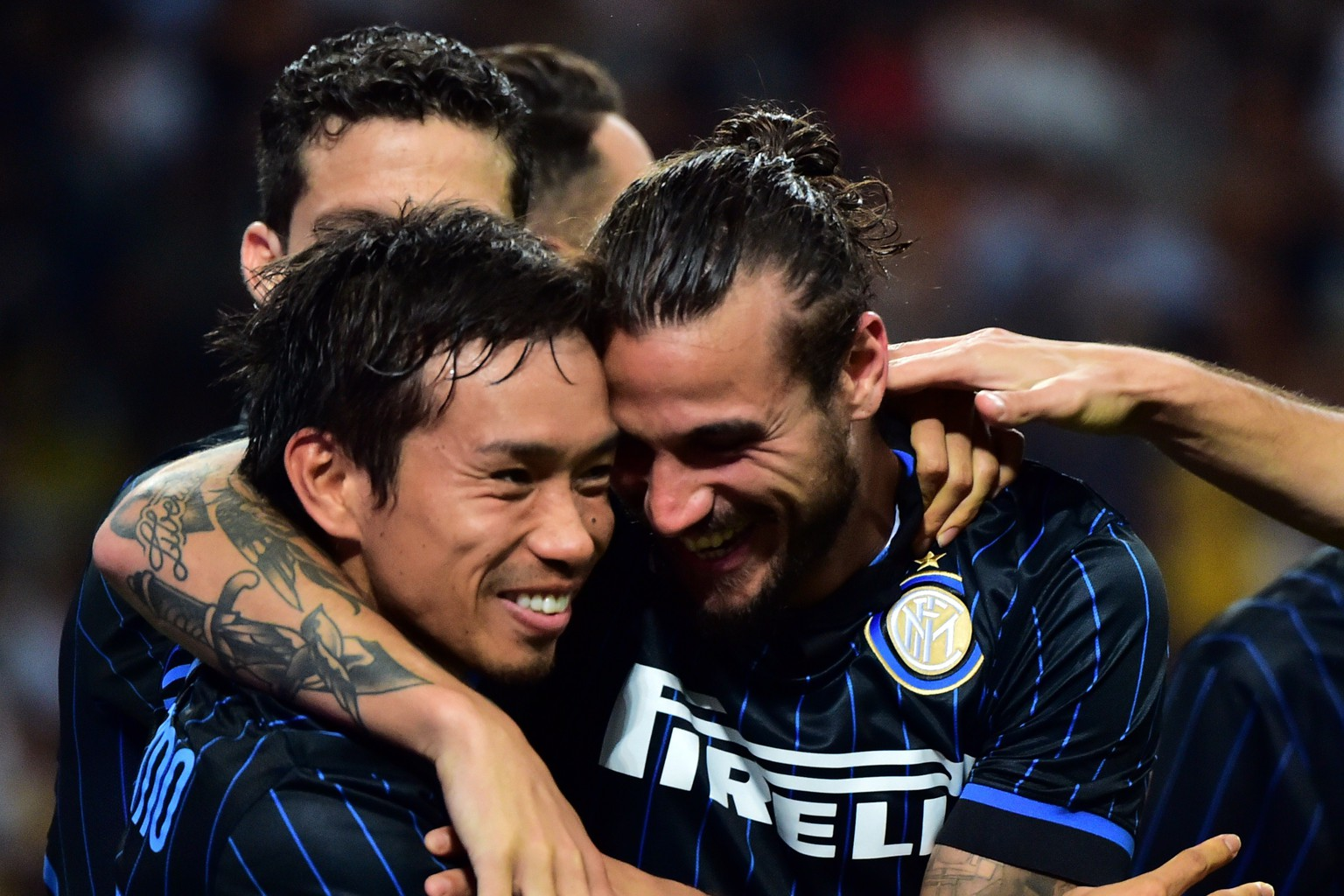Inter Milan's forward Pablo Osvaldo (R) celebrates with Inter Milan's japanese midfielder Yuto Nagatomo (L) after scoring a goal during the UEFA Europa League play-off football match between Inter Milan vs Stjarnan at San Siro Stadium in Milan on August 28, 2014. AFP PHOTO / GIUSEPPE CACACE