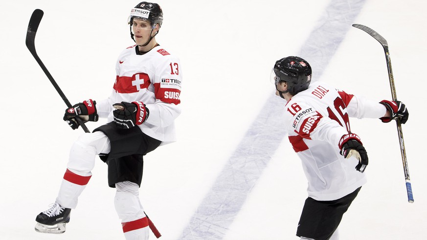 Switzerland's Felicien Du Bois, left, celebrates his goal past teammate Raphael Diaz, right, after scored the 3:3, during the IIHF 2016 World Championship preliminary round game between Norway and Switzerland, at the Ice Palace, in Moscow, Russia, Sunday, May 8, 2016. (KEYSTONE/Salvatore Di Nolfi)