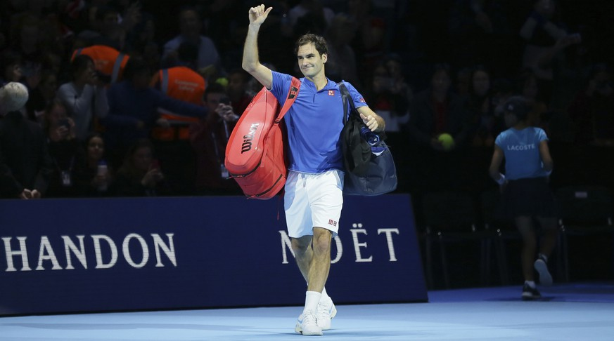 Roger Federer of Switzerland walks off court after losing to Alexander Zverev of Germany in their ATP World Tour Finals singles tennis match at the O2 Arena in London, Saturday Nov. 17, 2018. (AP Photo/Tim Ireland)