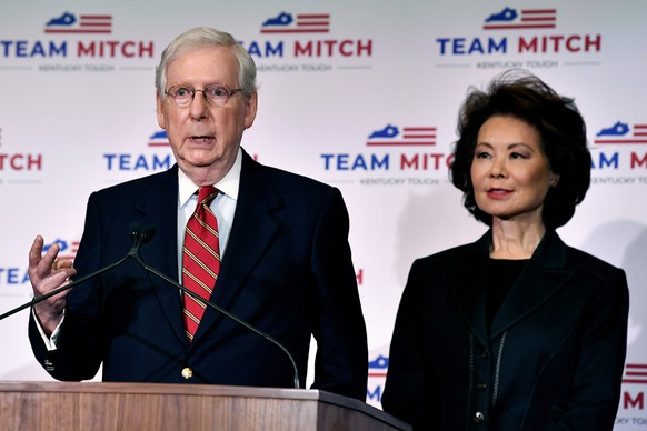 Senate Majority Leader Mitch McConnell, R-Ky., left, and his wife, Transportation Secretary Elaine Chao respond to a reporter's question during a press conference in Louisville, Ky., Wednesday, Nov. 4, 2020. McConnell secured a seventh term in Kentucky, fending off Democrat Amy McGrath. (AP Photo/Timothy D. Easley)
