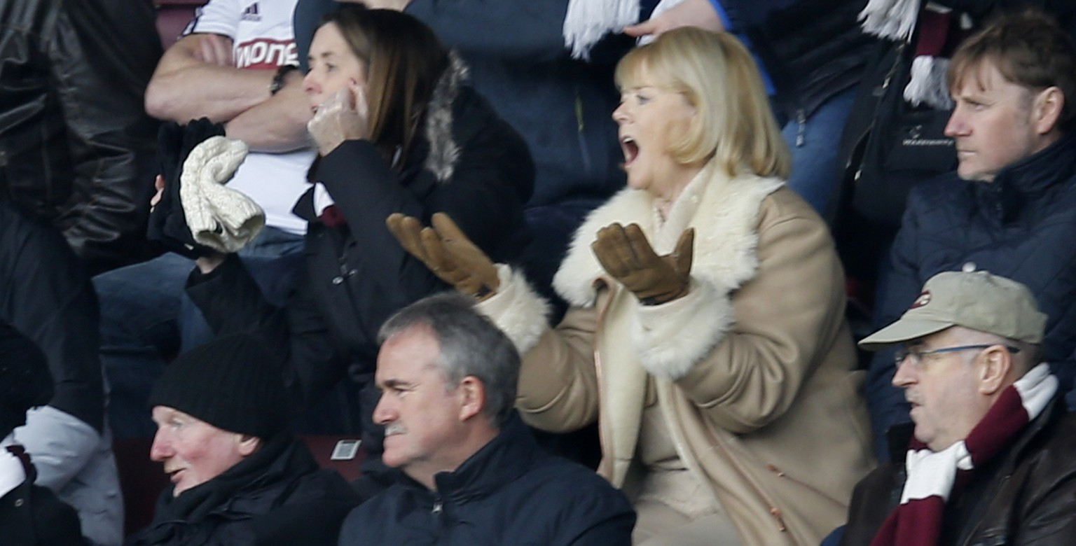 Ann Budge (R), Executive Chairwoman Designate of Heart of Midlothian Football club, reacts to her side's performance during their Scottish Premier League soccer match against Celtic at Tynecastle Stadium, Edinburgh, February 22, 2014. REUTERS/Russell Cheyne (BRITAIN - Tags: SPORT SOCCER)