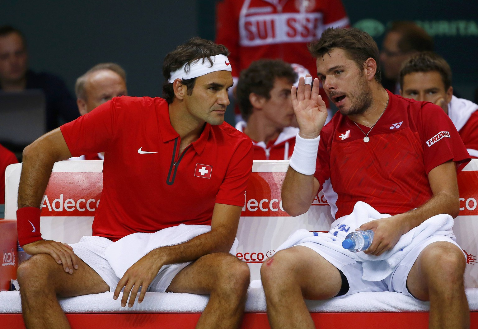 Switzerland's Stanislas Wawrinka (R) talks to Roger Federer during their Davis Cup quarter-final tennis match against Andrey Golubev and Aleksandr Nedovyvesov of Kazakhstan in Geneva April 5, 2014.  REUTERS/Denis Balibouse (SWITZERLAND  - Tags: SPORT TENNIS)