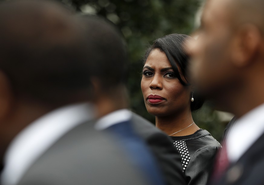 FILE - In this Feb. 28, 2017 file photo, White House Director of communications for the Office of Public Liaison Omarosa Manigault Newman stands with the of leaders of Historically Black Colleges and Universities (HBCU) outside the West Wing of the White House in Washington. The White House says former aide Omarosa Manigault Newman has
