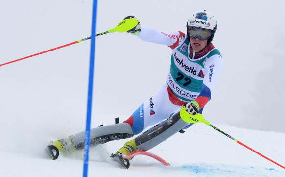 Daniel Yule, of Switzerland, competes during the first run of an alpine ski, men's slalom in Adelboden, Switzerland, Sunday, Jan. 11, 2015. (AP Photo/Pier Marco Tacca)
