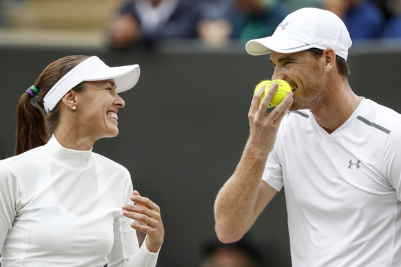 Martina Hingis of Switzerland, left, and Jamie Murray of Great Britain during their mixed doubles match against Roman Jebavy and Lucie Hradecka of Czech Republic, during the Wimbledon Championships at the All England Lawn Tennis Club, in London, Britain, 11 July 2017. (KEYSTONE/Peter Klaunzer)