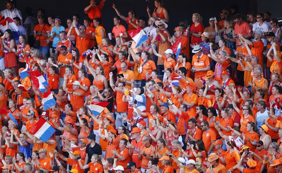 Netherlands fans celebrate at the end of the Women's World Cup quarterfinal soccer match between Italy and the Netherlands, in Valenciennes, France, Saturday, June 29, 2019. (AP Photo/Francois Mori)