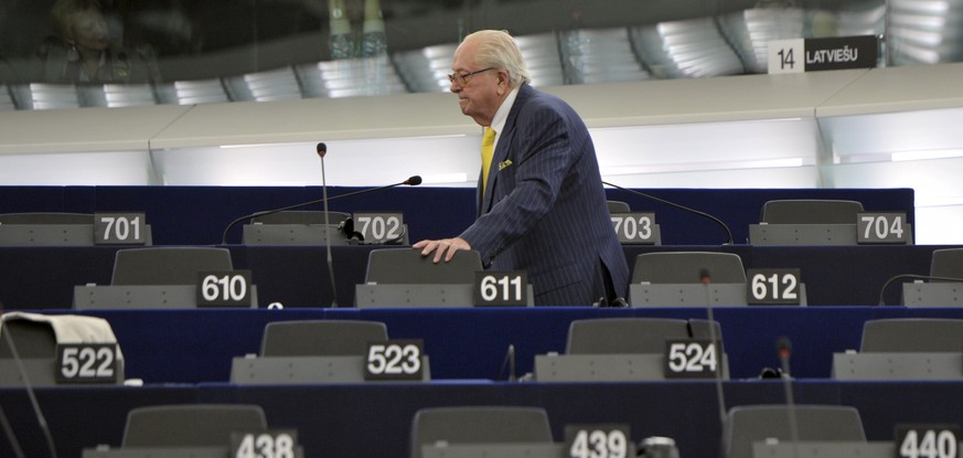 FILE - In this July 1, 2014 file photo, French former far right National Front leader Jean Marie Le Pen looks for his seat at the European Parliament, in Strasbourg, eastern France. A pact of sorts may end the bloodletting between Le Pen and her 86-year-old father, Jean-Marie Le Pen, a party founder whose latest anti-Semitic remarks have tripped up the efforts of his daughter to give the National Front a new look. She announced on national television she will oppose his candidacy in December regional elections. (AP Photo/Christian Lutz, File)