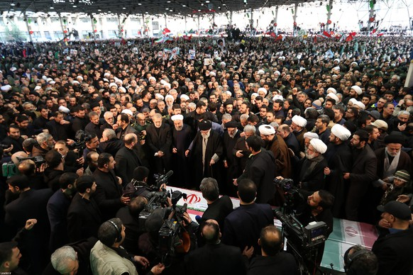 epa08107308 A handout photo made available by Iranian Supreme Leader's Office shows Iranian Supreme Leader Ayatollah Ali Khamenei (C) praying before the coffins of slain Iranian Revolutionary Guards Corps (IRGC) Lieutenant general and commander of the Quds Force Qasem Soleimani and of other victims as Iranian President Hassan Rouhani (C-L) and other top officials attend the funeral ceremony in Tehran, Iran, 06 January 2020. Soleimani was killed in a targeted US airstrike on 03 January 2020 in Baghdad, Iraq.  EPA/IRAN'S SUPREME LEADER OFFICE HANDOUT  HANDOUT EDITORIAL USE ONLY/NO SALES