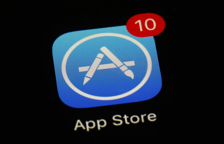 FILE - This March 19, 2018 file photo shows Apple's App Store app in Baltimore. Since its debut 10 years ago Tuesday, July 10, 2018, Apple's app store has unleashed new ways for us to work, play, and become lost in our screens. (AP Photo/Patrick Semansky, File)
