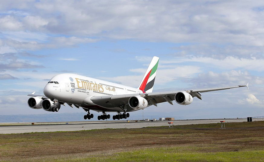 IMAGE DISTRIBUTED FOR EMIRATES - Emirates' inaugural A380 flight to San Francisco International Airport touches down on Monday, Dec. 1, 2014, in San Francisco. (Tony Avelar/AP Images for Emirates)
