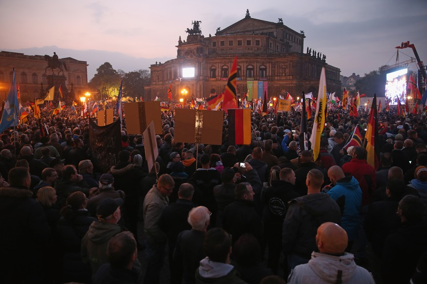 DRESDEN, GERMANY - OCTOBER 19:  Supporters of the Pegida movement gather at Theaterplatz square on the first anniversary since the first Pegida march on October 19, 2015 in Dresden, Germany. Pegida is an acronym for 'Patriotische Europaeer Gegen die Islamisierung des Abendlandes,' which translates to 'Patriotic Europeans Against the Islamification of the West,' and has strengthened its following since the surge of migrants and refugees arriving in Germany since August. A movement spokesman is demanding an immediate stop to Germany's admission of migrants and exclusion of all refugees and asylum seekers who are not Christians. Germany is expecting to receive well over one million asylum applicants this year and the challenge of accommodating and integrating so many people is creating divisions in German society that are becoming increasingly radical.  (Photo by Sean Gallup/Getty Images)