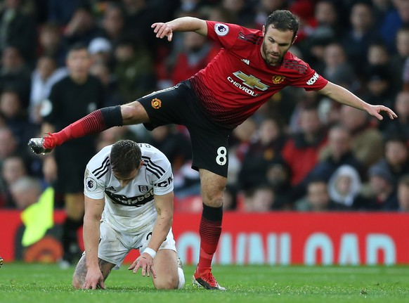 epa07217592 Manchester United's Juan Mata (R) in action with Fulham's Joe Bryan during the English Premier League soccer match between Manchester United and Fulham at the Old Trafford stadium in Manchester, Britain, 08 December 2018.  EPA/Nigel Roddis EDITORIAL USE ONLY. No use with unauthorized audio, video, data, fixture lists, club/league logos or 'live' services. Online in-match use limited to 75 images, no video emulation. No use in betting, games or single club/league/player publications