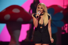 FILE - In this Sept. 21, 2013 file photo, Britney Spears introduces Miley Cyrus at IHeartRadio Music Festival, day 2, in Las Vegas. The
