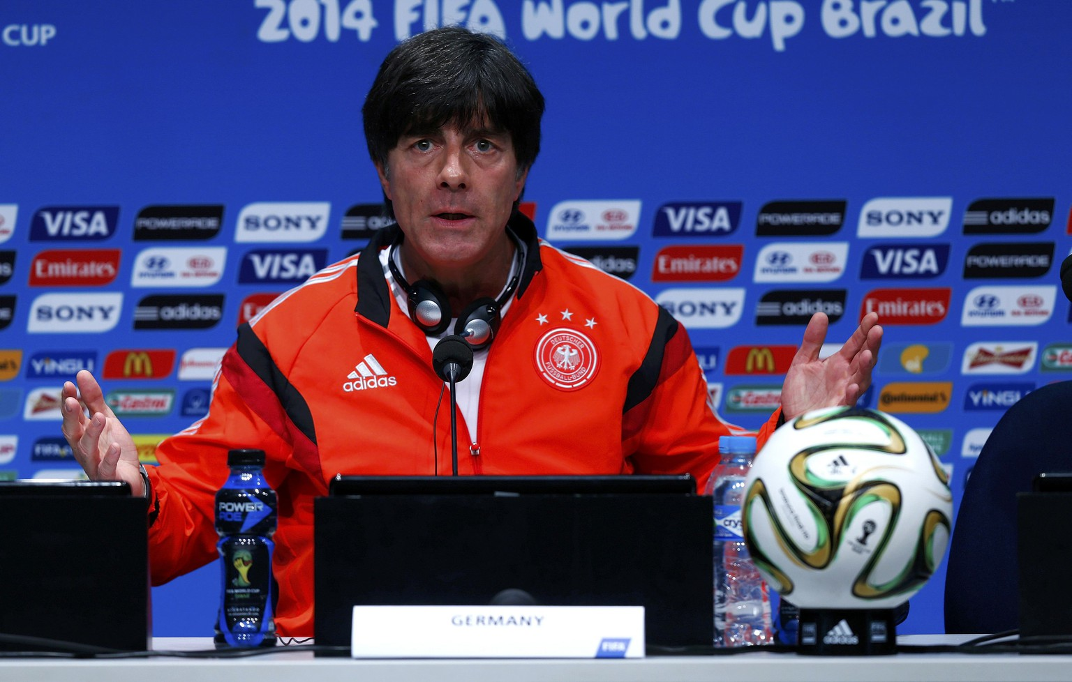 Germany's coach Joachim Loew gestures during a news conference at the Maracana stadium in Rio de Janeiro July 12, 2014, ahead of their 2014 World Cup Final soccer match against the Argentina on Sunday.    REUTERS/Eddie Keogh (BRAZIL  - Tags: SOCCER SPORT WORLD CUP)