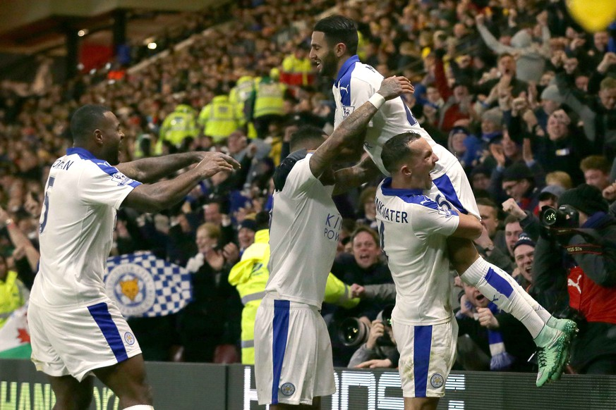 Leicester's Riyad Mahrez is lifted by his teammates as he celebrates after scoring a goal during the English Premier League soccer match between Watford and Leicester City at the Vicarage Road stadium in London, Saturday, March 5, 2016. (AP Photo/Tim Ireland)